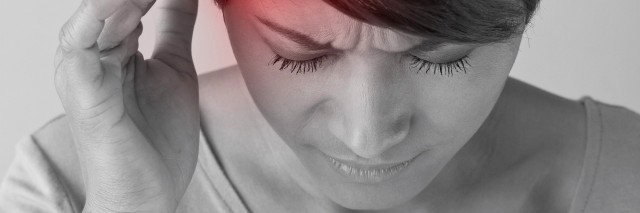 woman with pain, headache, migraine, stress, insomnia, hangover in casual dress, hand holding head, front view closeup