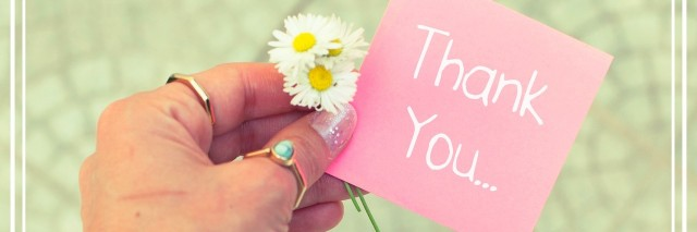 hand holding a paper that says Thank You