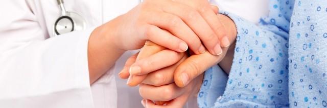 Medical doctor holing senior patient's hands