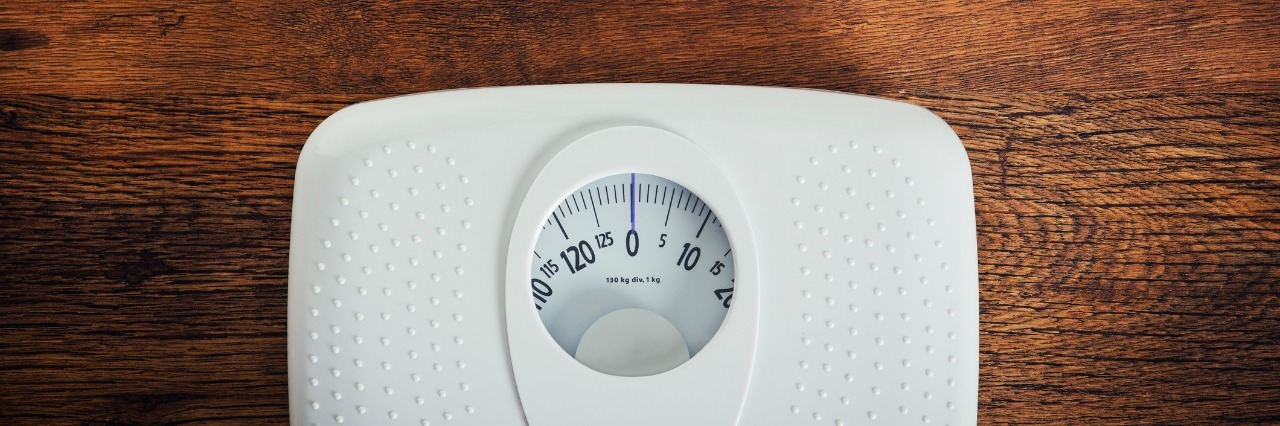 weight scale on hardwood floor
