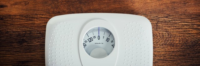 weight scale on hardwood floor