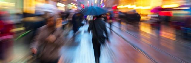 crowded, blurry street on a rainy day