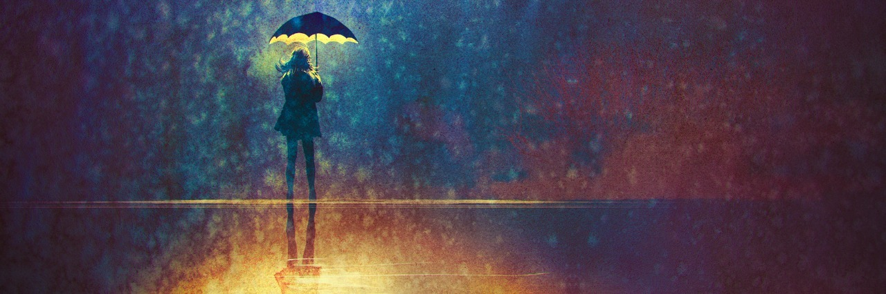 woman under umbrella in the rain
