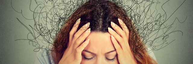 stressed out woman with abstract thought lines coming from her head
