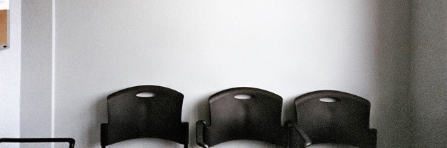 chairs against a wall in a waiting room