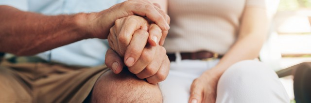 close up on the hands of a loving couple sitting together