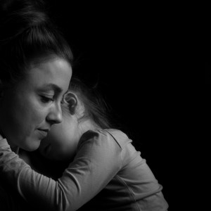 Black and white Picture of a child hugging her mother.Silhuette picture.