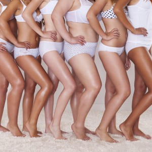 woman standing in a line with diverse bodies and skin tones