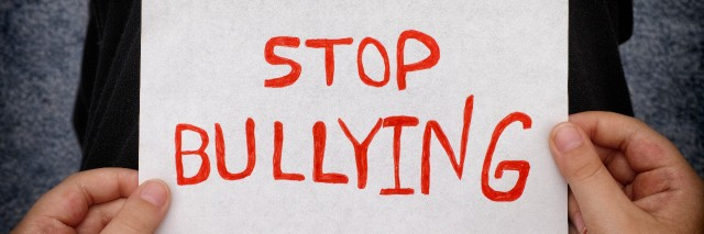 Boy holds Stop Bullying sign.