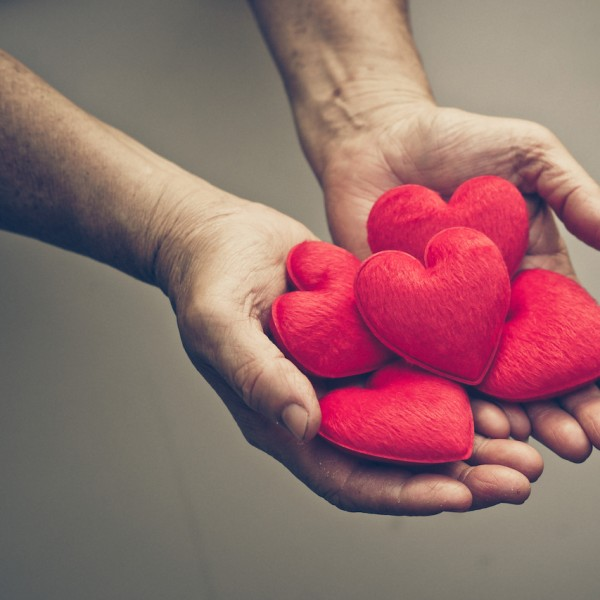 A man holding hearts