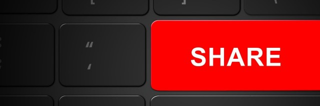 a bright red share button on a keyboard