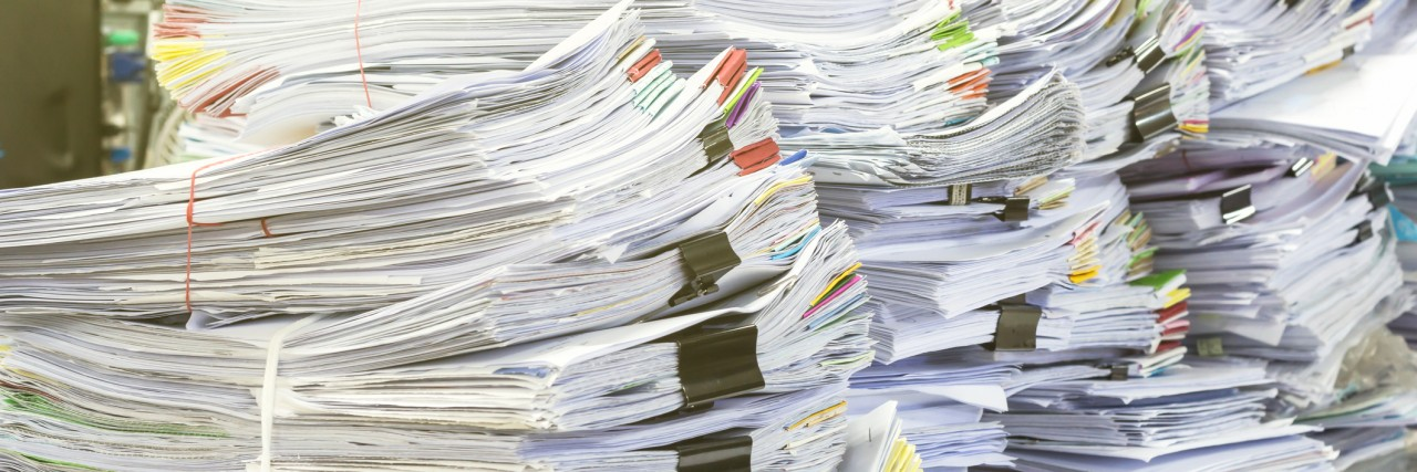 Pile of documents on desk stack