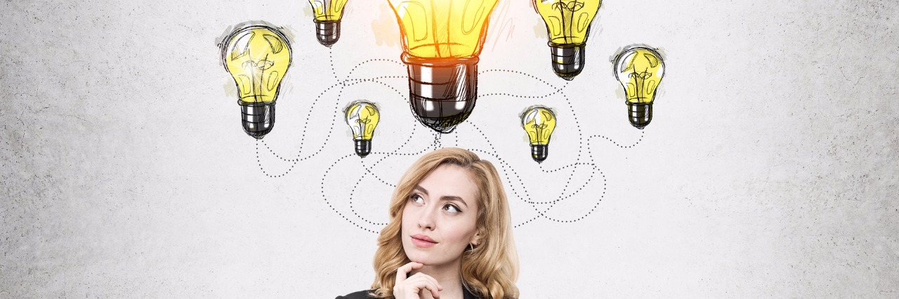 businesswoman thinking with a lightbulb over her head