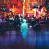 blue man walking in futuristic city with colorful light
