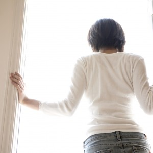 woman standing in doorway looking out