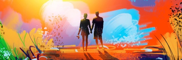 silhouette of couple holding hands and watching colorful sunset