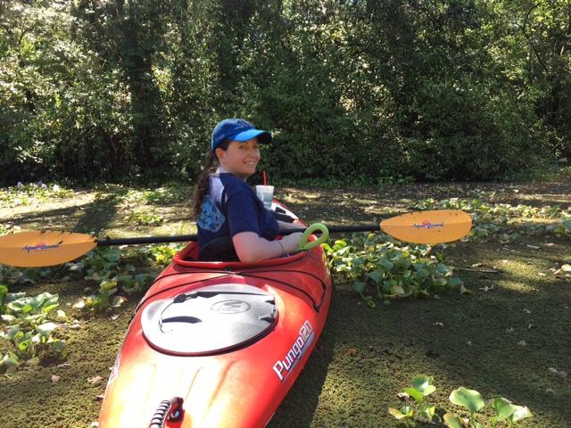 woman kayaking in a lake