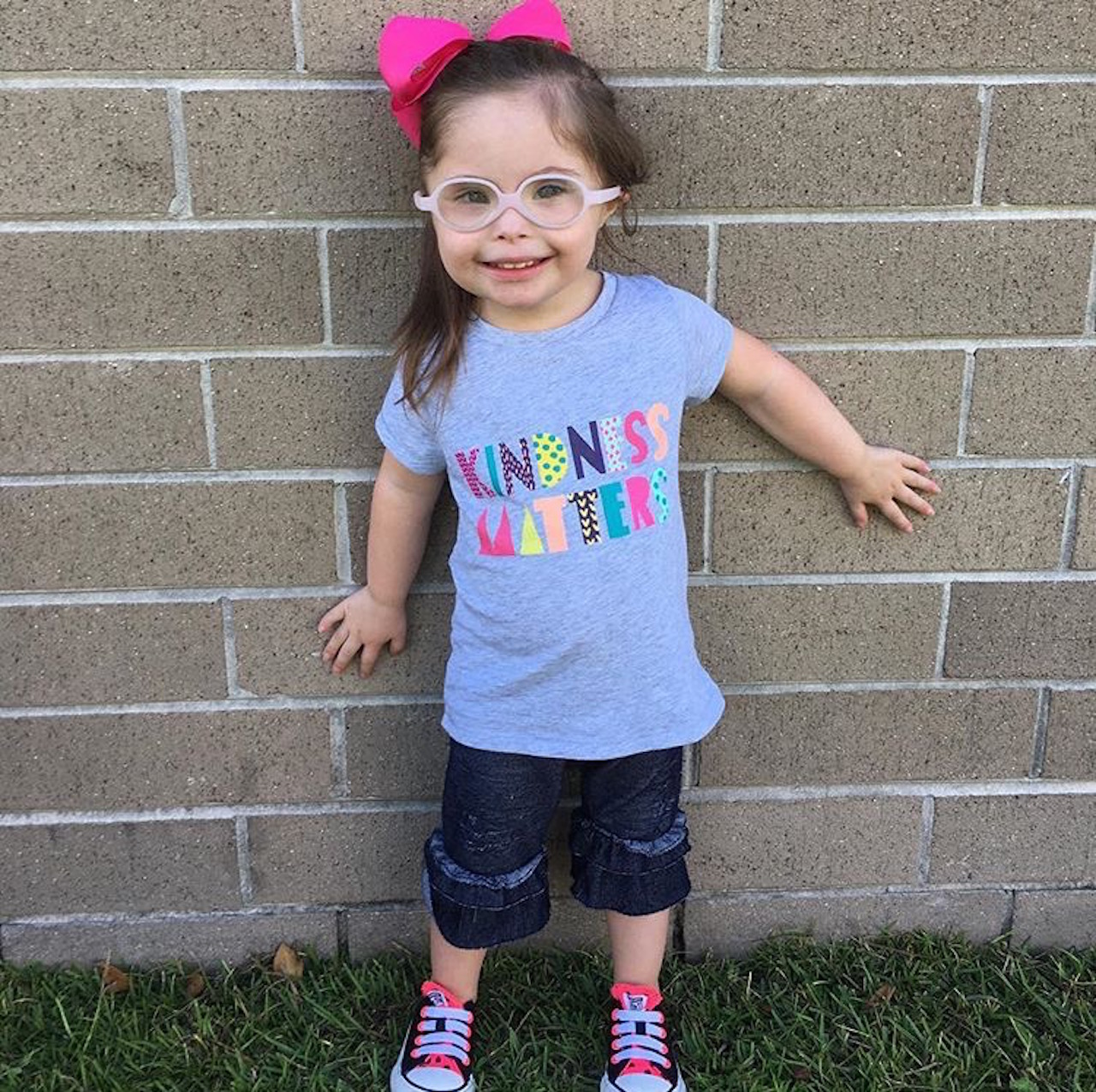 little girl wearing a shirt that says kindness matters