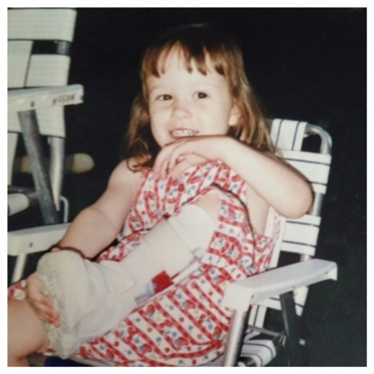 Annie wearing her leg brace as a child.