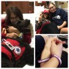Arianna in the hospital with friends and a therapy dog