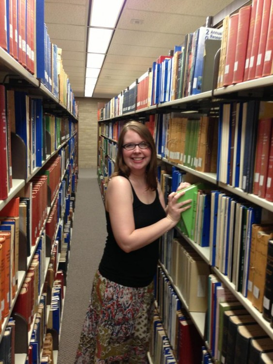 woman shelving books in the library