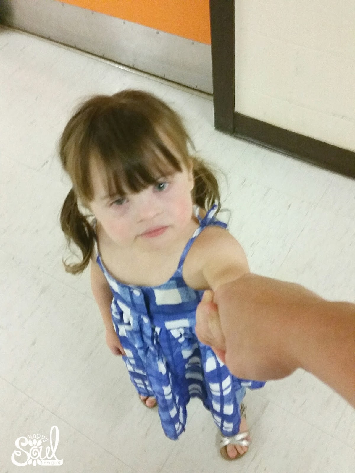 little girl holding mom's hand