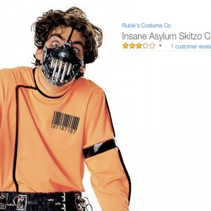 A man dressed is a jumpsuit with a scary mask. Text reads: Insane Asylum Skitzo Costume