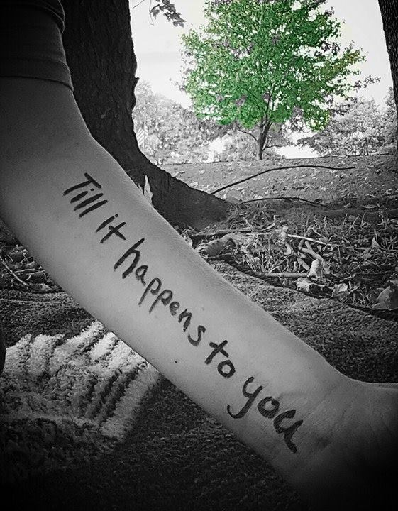 arm with words till it happens to you written in black ink