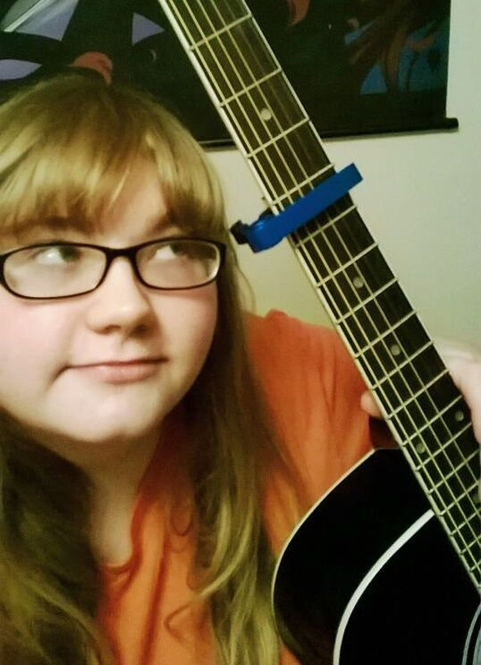A girl with her guitar