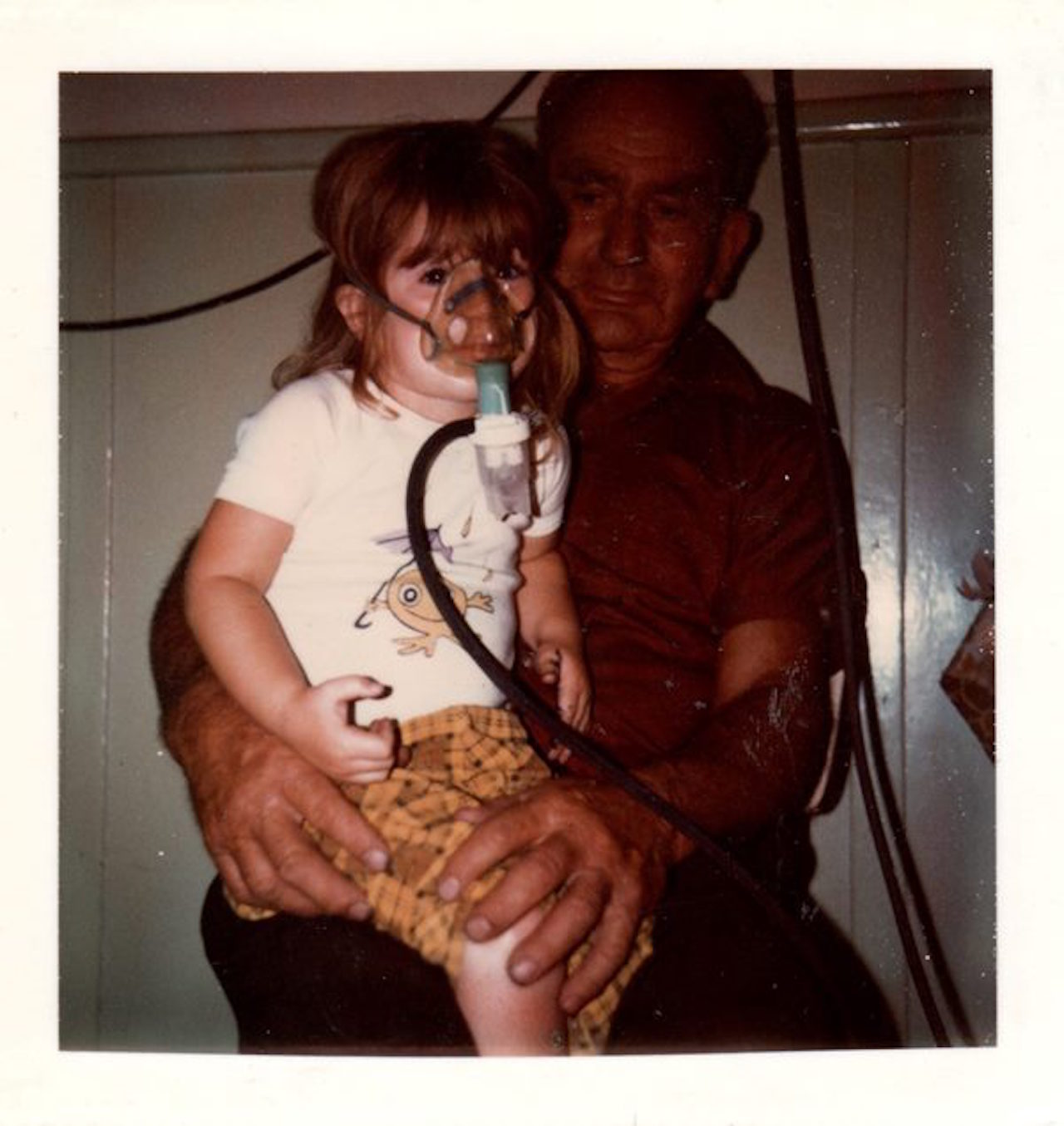girl with cystic fibrosis doing physio with her dad