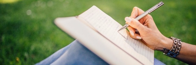 writing in a journal outside