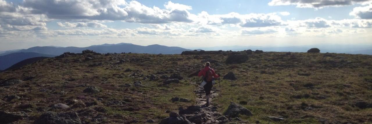 man hiking beautiful trail