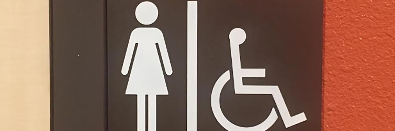 Women's bathroom sign.
