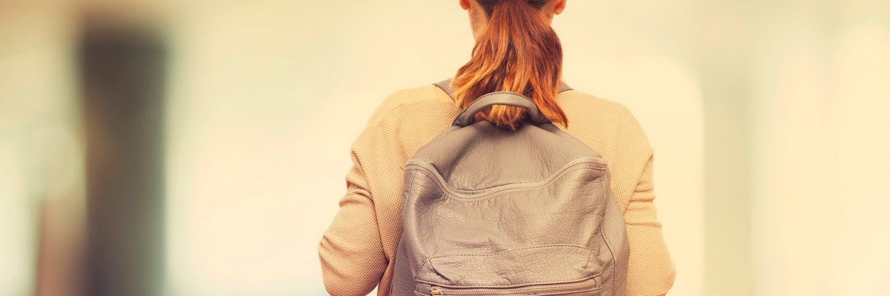college student carrying a backpack