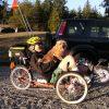 man sitting on recumbent bike with dog on lap