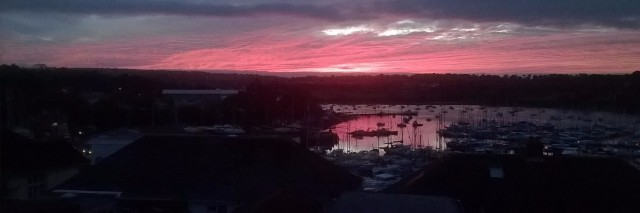 view of pink sky over town