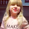 young girl with a make today awesome t-shirt