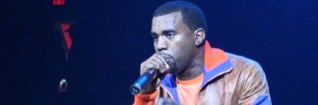 Kanye performing at a concert on stage