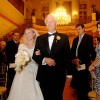 A bride walking down the aisle with her dad at her wedding