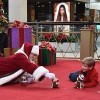 Santa laying on the floor playing with a boy with autism
