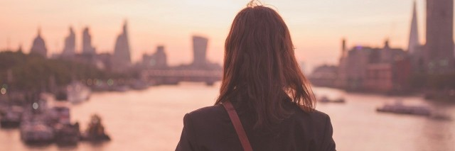 young woman admiring London at sunrise