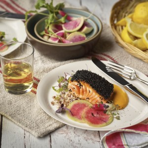 Photo of a salmon dish on a dinner table