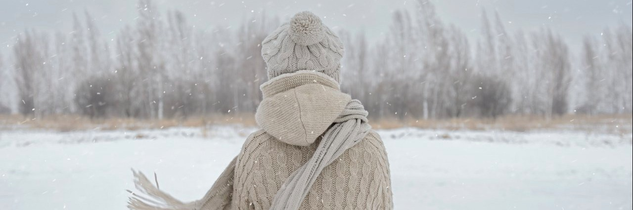 woman looking at the woods during winter
