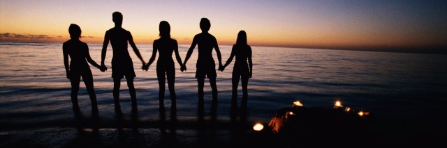 Group of friends holding hands, silhouette