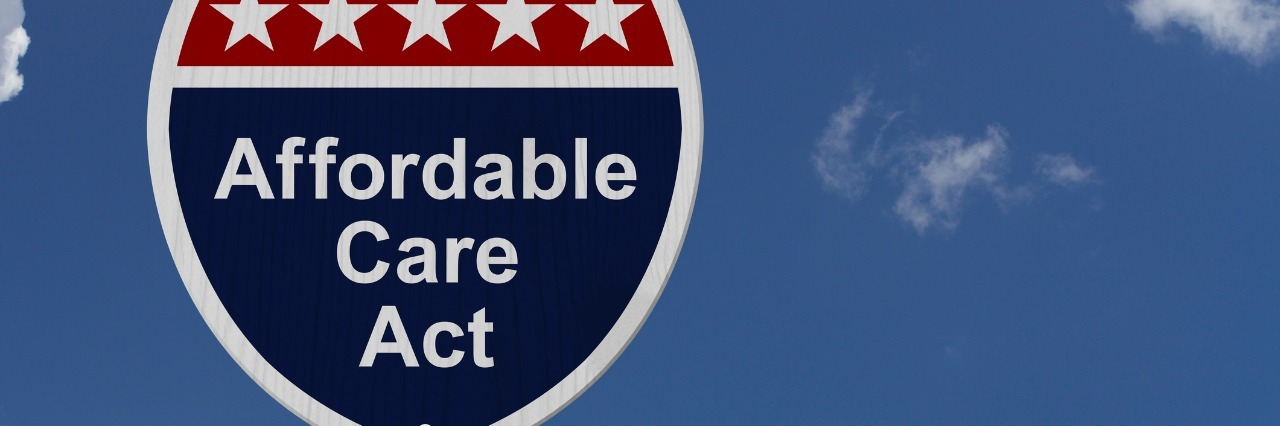 Affordable Care Act Sign, A red, white and blue highway sign with words Affordable Care Act and an arrow sign with sky background