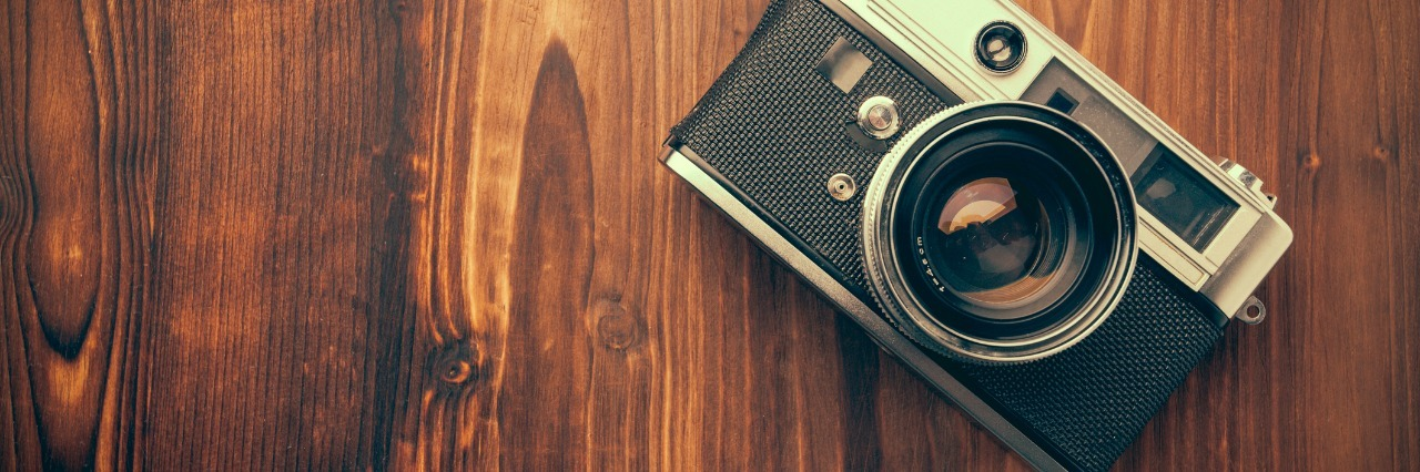 camera on a wooden table