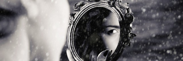 Girl watching mirror