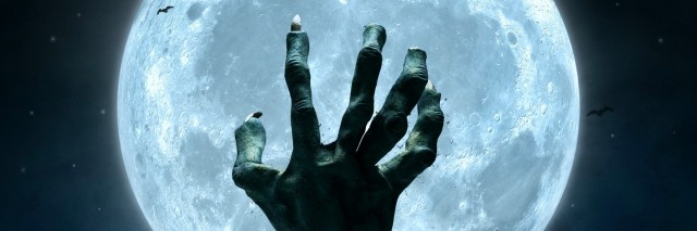 zombie hand coming out from the grave