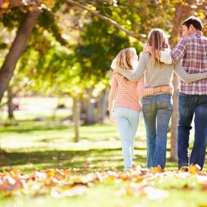 family of four walking outside in autumn