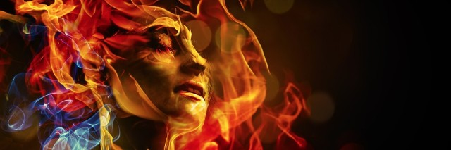 woman's face surrounded by colored flames